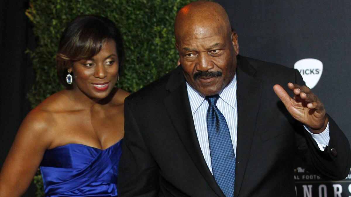 Hall of Fame running back Jim Brown and his wife Monique arrive for the Inaugural National Football League Honors at Super Bowl XLVI in Indianapolis, Indiana, February 4, 2012. REUTERS/Mike Segar
