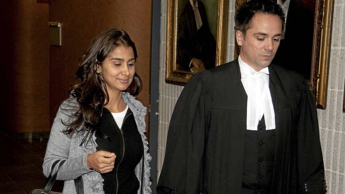 Amanda Rodrigues, widow of former boxing champion Arturo Gatti, leaves court in Montreal with her lawyer, Pierre-Hughes Fortin, on Wednesday.