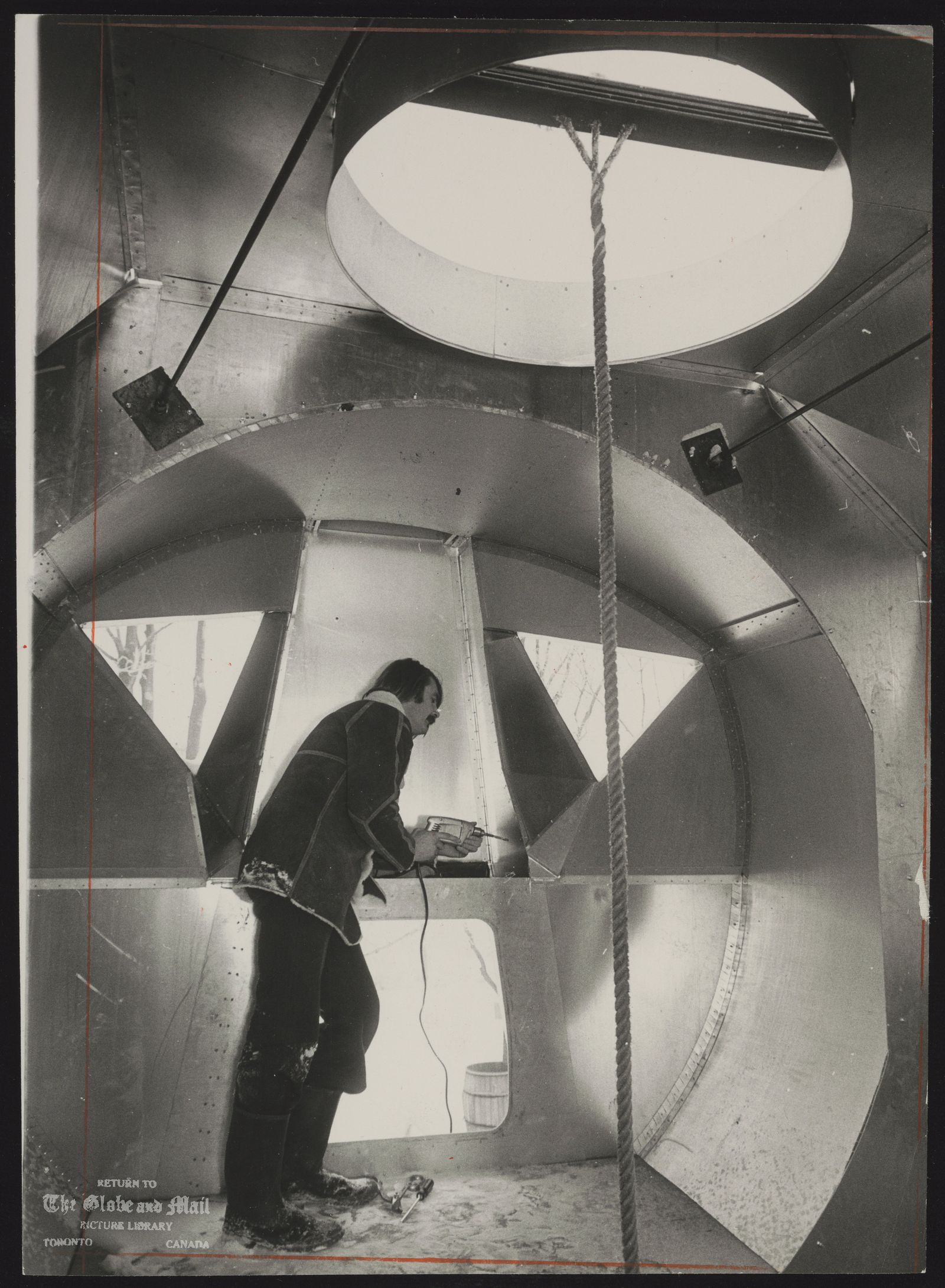 William LISHMAN Pickering sculptor (Lishman inside model of lunar landing module he built in his back yard. Plans to use it as a guest house)