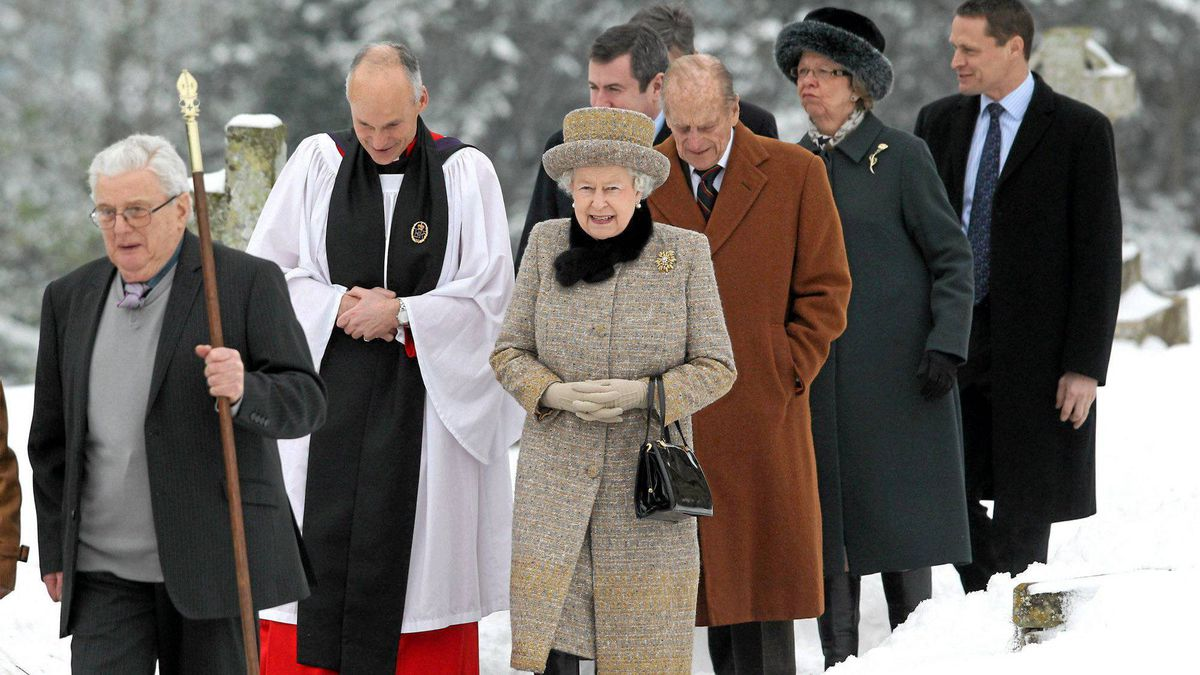 Britain's Queen Elizabeth, centre, and her husband Prince Philip, Duke of Edinburgh, third right, accompanied by an unidentified member of the clergy, arrive with others at the church of St.Peter and St. Paul at West Newton, eastern England, Feb. 5, 2012.