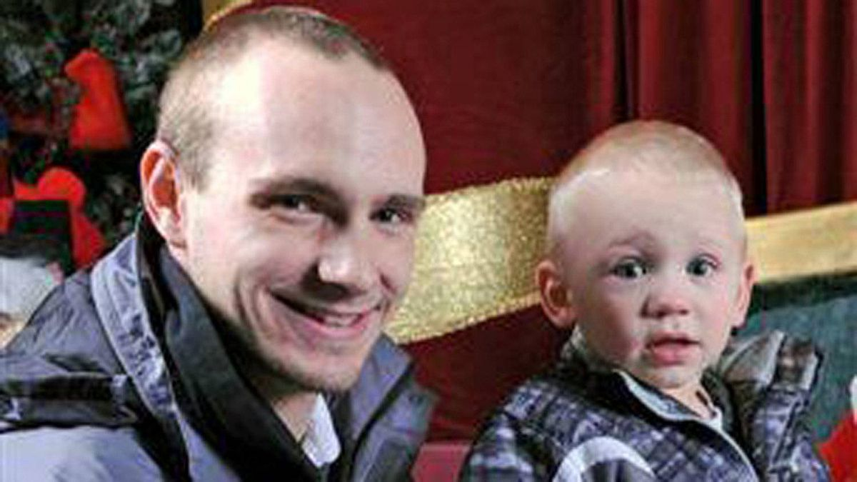Jason Eligh, pictured with his son Parker, was killed when a set of wheels came off a tractor trailer travelling in the opposite lane. This picture was taken about seven hours before he died.