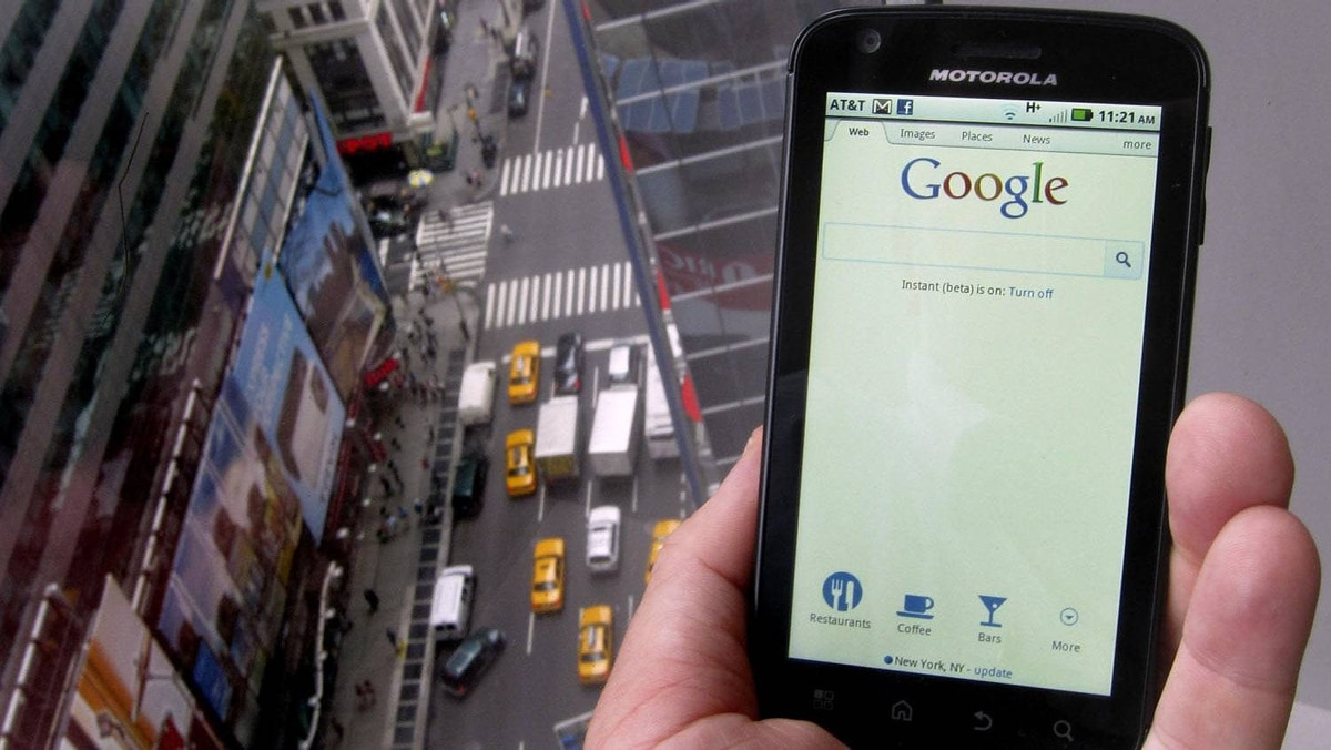 A posed picture shows a Motorola Droid phone displaying the Google search page in New York August 15, 2011.