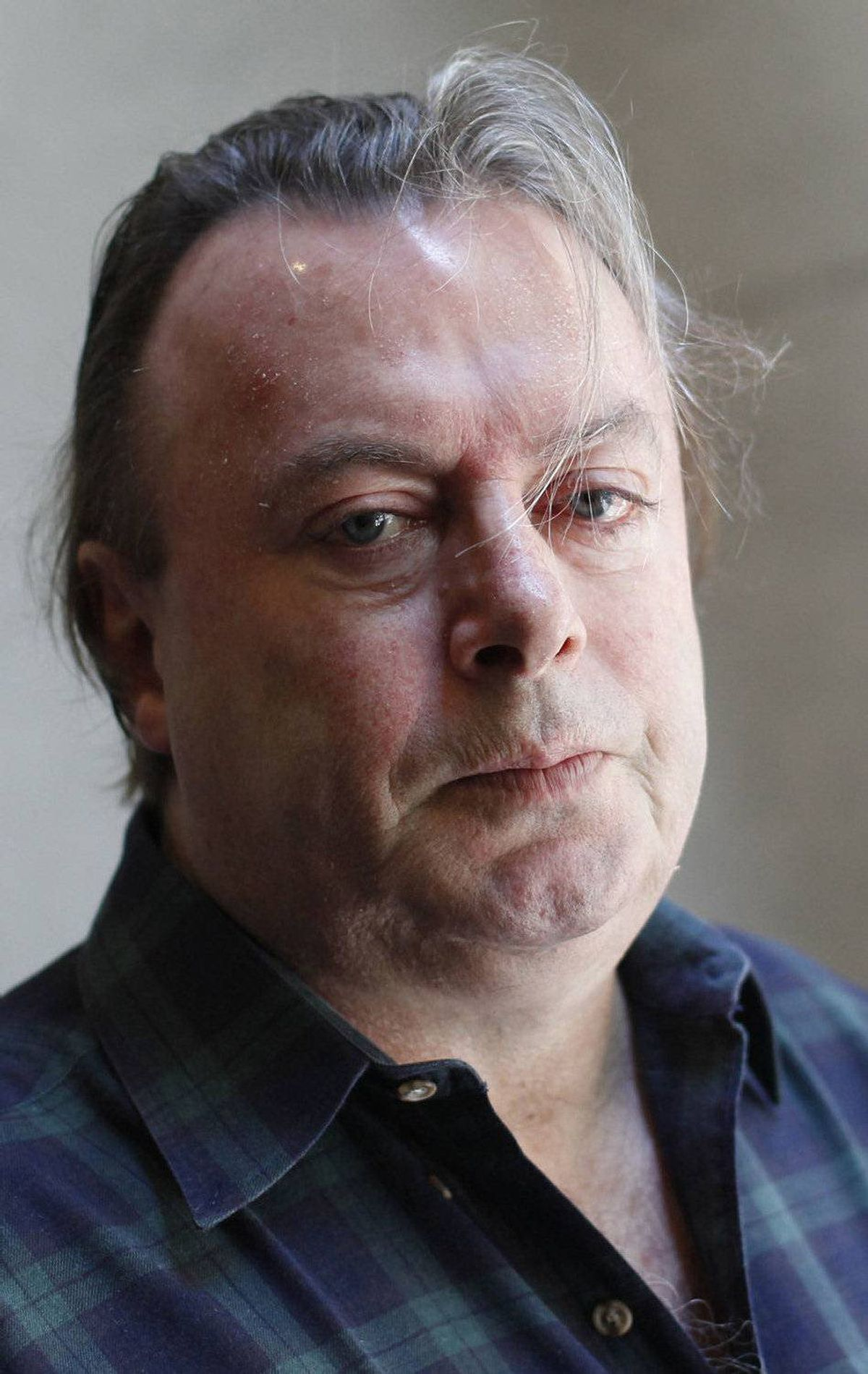 """Christopher Hitchens, journalist and author of his new memoir """"Hitch 22,"""" poses for a portrait outside his hotel in New York, June 7, 2010. Already infamous for being the socialist who called Margaret Thatcher sexy and as the contrarian who loved George W. Bush's war in Iraq, Hitchens now wants to rewrite the Ten Commandments. Picture taken June 7, 2010. REUTERS/Shannon Stapleton (UNITED STATES - Tags: ENTERTAINMENT SOCIETY)"""