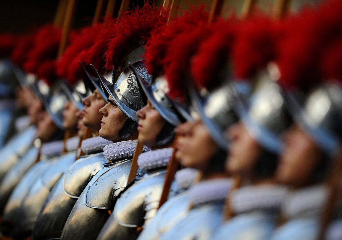 Swiss guards take part in a swearing-in ceremony on May 6, 2011 in the honour courtyard of the Swiss guard at the Vatican. 34 Swiss guards were sworn-in on the anniversary of the 1527 sacking of Rome where 147 Swiss guards died.