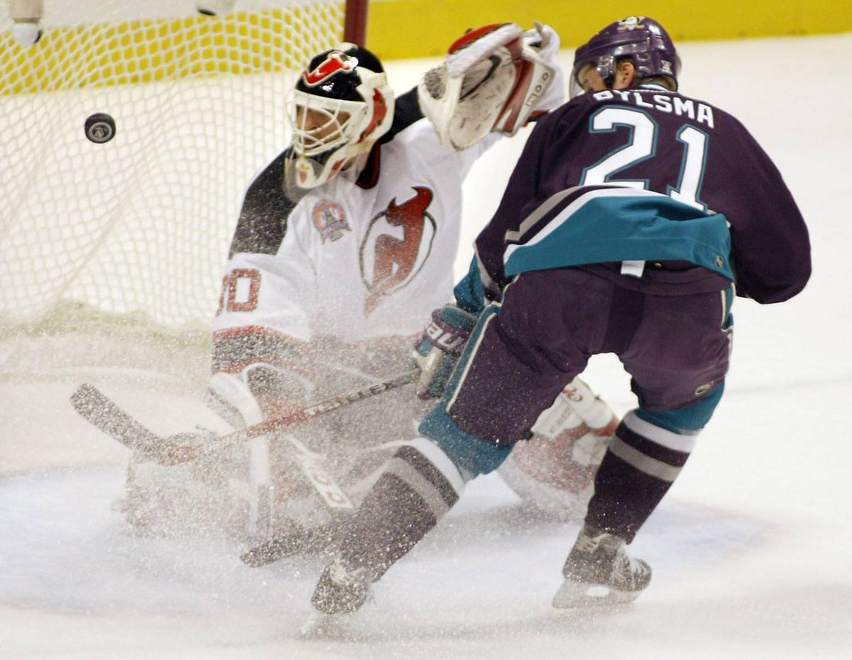 New Jersey Devils goaltender Martin Brodeur makes the save off Anaheim Mighty Ducks forward Dan Bylsma during Game 7 of the 2003 Stanley Cup final.