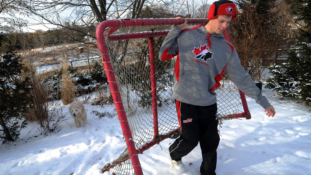 Mark Visentin, goaltender for the Canadian World Juniors is photographed with his dog Sheeba at the family home in Waterdown, Ont. Jan. 7/2011. (photo by Kevin Van Paassen/The Globe and Mail)