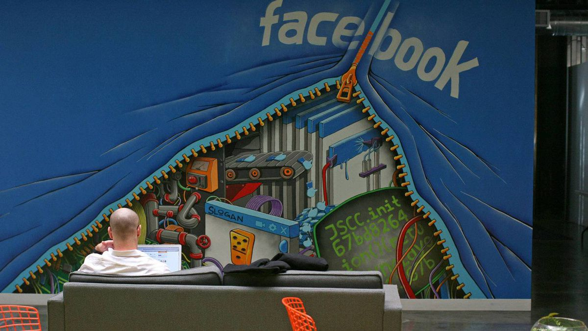 An employee works on a computer at the headquarters of Facebook in Menlo Park, Calif.