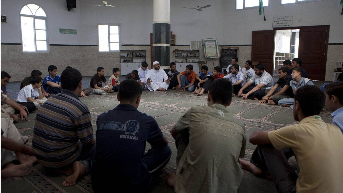 Ayman Batniji , spokesman for the Hamas police and religious leader in the Shouada Al Aqsa Mosque Gaza CIty as he preaches to young Muslim teenagers June 17,2010.