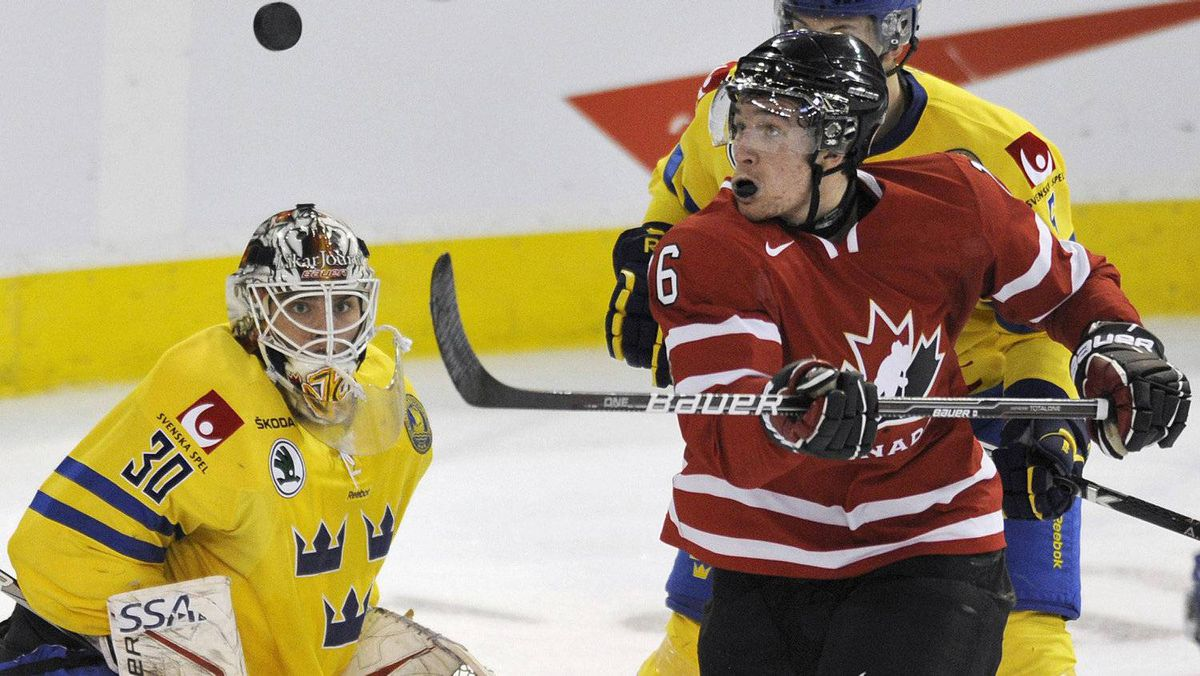 Team Sweden goalie Johan Gustafsson (L) and Team Canada's Mark Stone (R) watch the puck during the second period of their exhibition hockey game in Edmonton December 23, 2011. REUTERS/Dan Riedlhuber