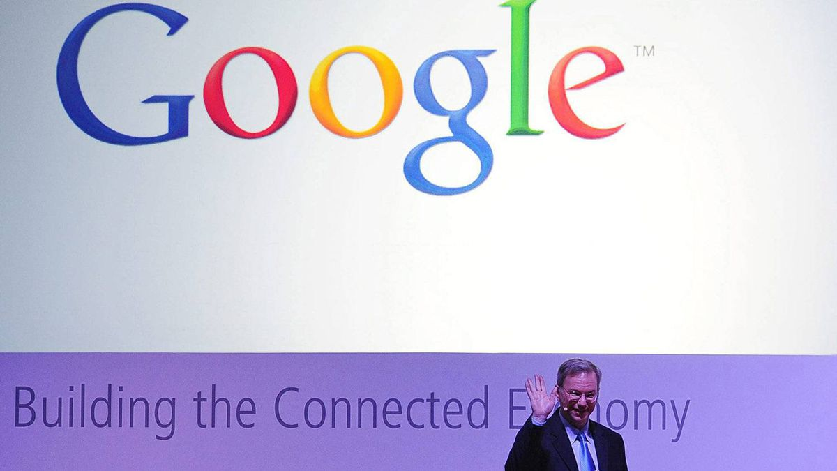 CEO of Google Inc. Eric Schmidt waves during a conference at the Mobile World Congress in Barcelona, Spain.