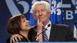 Bloc Quebecois Leader Gilles Duceppe gets his face wiped by his wife Yolande Brunelle as he enters to speak to supporters Monday, May 2, 2011 in Montreal. Duceppe announced his resignation.