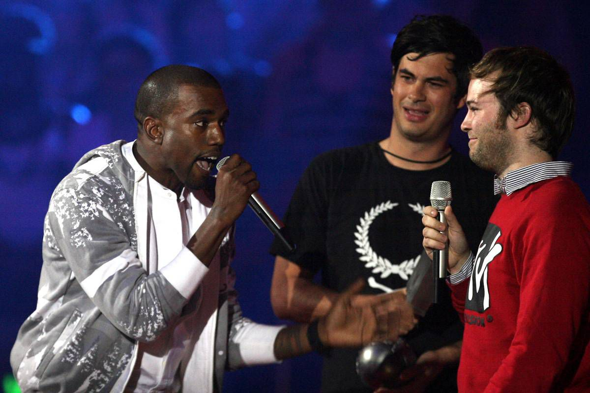 "Kanye West, left, complains alongside Jeremie Rozan and Martial Schmeltz, directors of the video for ""We Are Your Friends"" by Justice Vs Simian at the MTV Europe Music Awards in Copenhagen on Nov. 2, 2006."