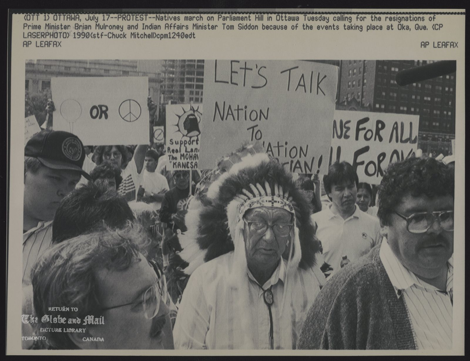 INDIANS CANADA (OTT 1) OTTAWA, July 17--PROTEST-Natives march on Parliament Hill in Ottawa Tuesday calling for the resignations of Prime Minister Brian Mulroney and Indian Affairs Minister Tom Siddon because of the events taking place at Oka, Que. (CP Laserphoto) 1990 (stf-Chuck Mitchell)cpm124edt