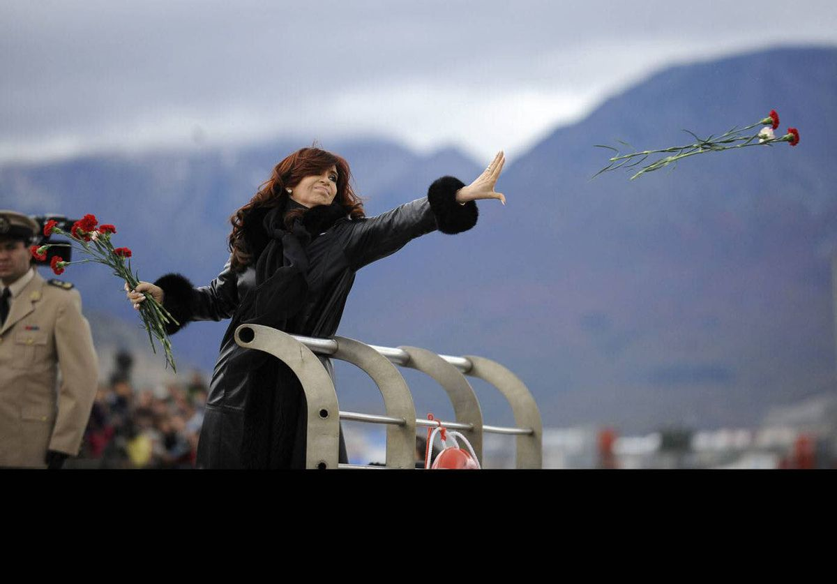 Argentine President Cristina Fernandez de Kirchner throws flowers into the Bahia de Ushuaia (Ushuaia Bay) waters to pay homage to fallen soldiers on the 30th anniversary of the Falklands War.