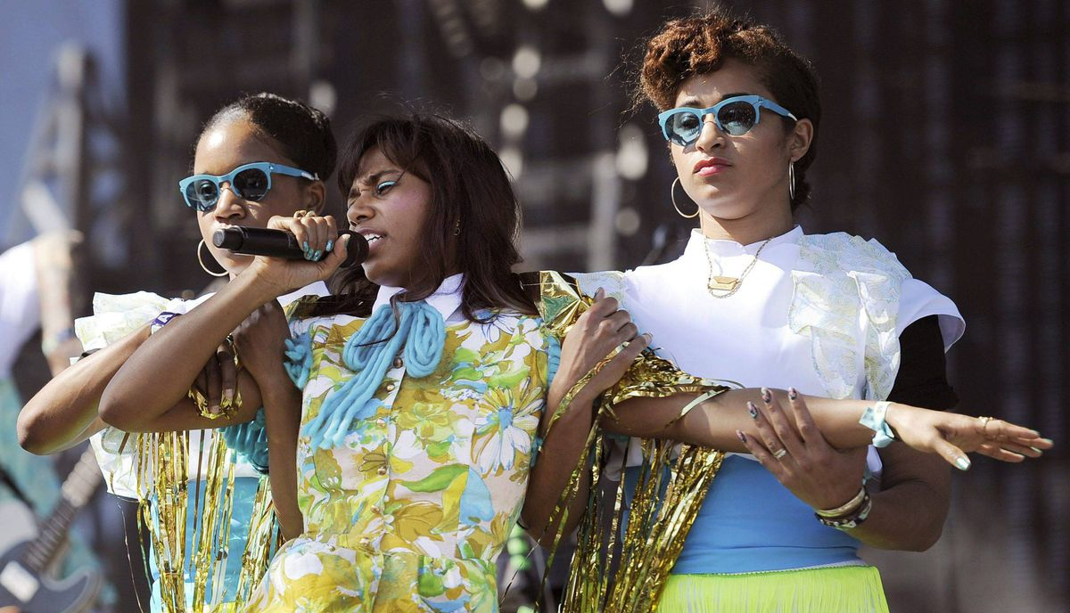 Santigold, center, performs with backup dancers during her set on the first weekend of the 2012 Coachella Valley Music and Arts Festival.