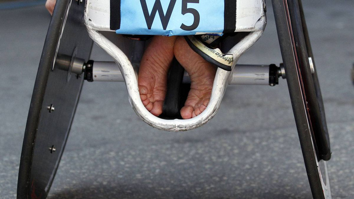 The feet of Joshua Cassidy of Canada are tucked into his wheelchair after he won the men's wheelchair division of the 116th Boston Marathon in Boston, Massachusetts April 16, 2012.