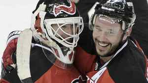 New Jersey Devils goalie Martin Brodeur (L) is congratulated by teammate Ilya Kovalchuk after the Devils defeated the Philadelphia Flyers on Brodeur's 40th birthday in Game 4 of their NHL Eastern Conference semi-final playoff hockey game in Newark, New Jersey, May 6, 2012. REUTERS/Ray Stubblebine