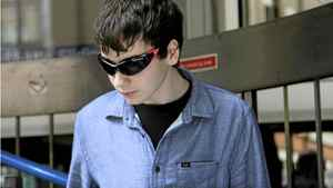 Suspected British computer hacker, Jake Davis, leaves City of Westminster Magistrates' Court after being released on bail, London August 1, 2011. Davis appeared in court on Monday charged with hacking offences, including hacking into the website of the Serious Organised Crime Agency (SOCA).