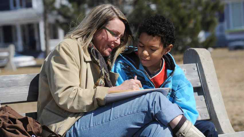 Krista Steeves sketches on a bench in Wilmot Park in Fredericton with her son Blair Steeves, 11, on April 17, 2011.