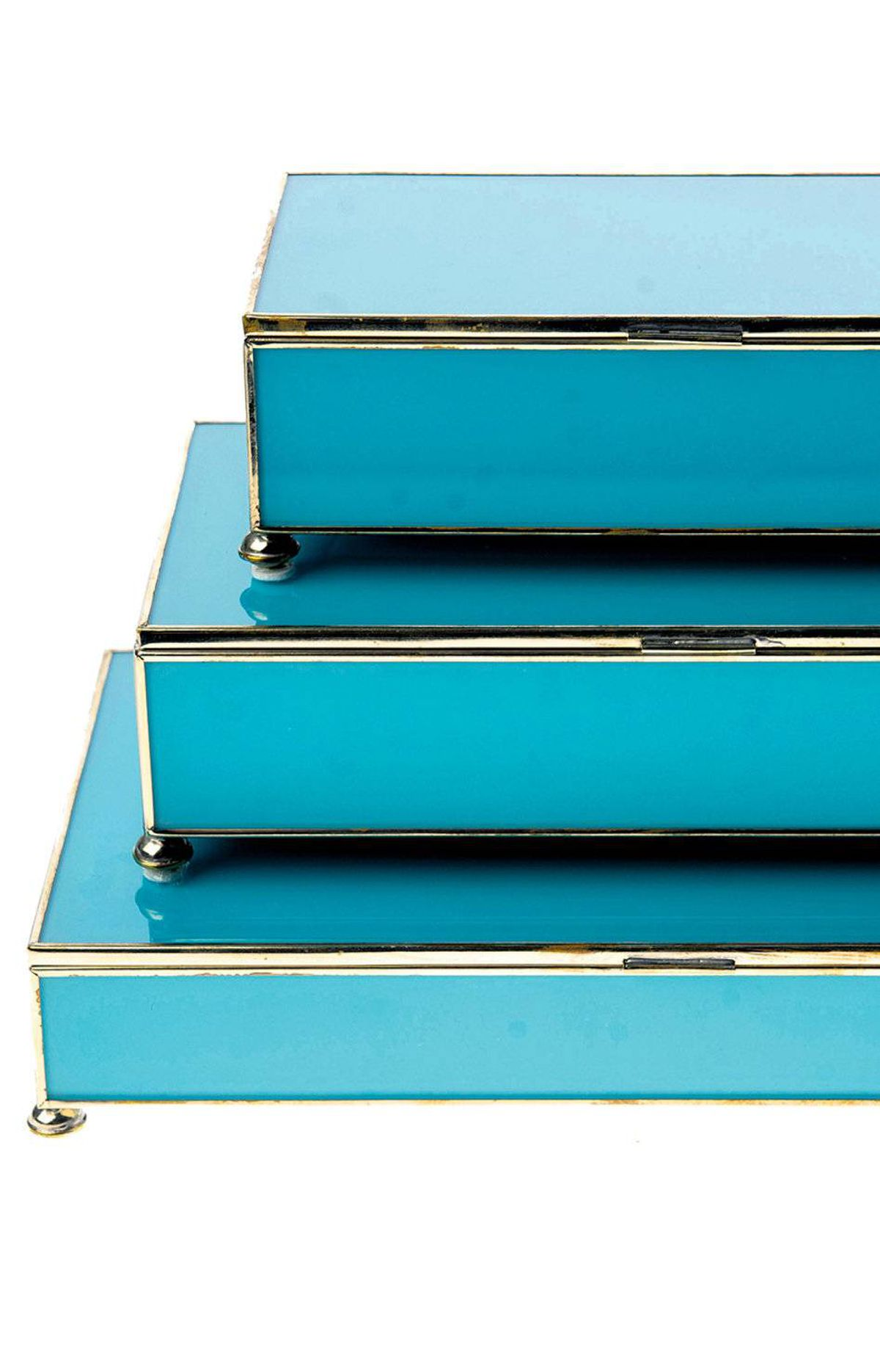 As chic as they are practical, decorative boxes both dress up bookshelves and other surfaces and hide remotes from view. 1212 glass stacking boxes in Tiffany Blue, $115 to $210 through www.1212decor.com.