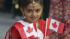 Shahnaz Begum smiles as she enjoys the annual Canada Day celebrations in Montreal, Friday, July 1, 2011.