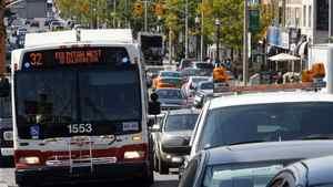 A TTC bus battles traffic on Eglinton Avenue.