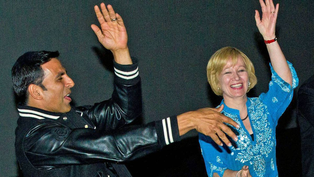 Tory Leader Stephen Harper's wife, Laureen, dances with Bollywood star Akshay Kumar prior to the Canadian premier of his filme Thank You at a campaign event in Brampton, Ont., on April 8, 2011.