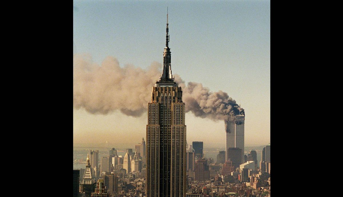 The twin towers of the World Trade Center burn behind the Empire State Building in New York in this Sept. 11, 2001 file photo, after hijacked jetliners plunged into both towers.