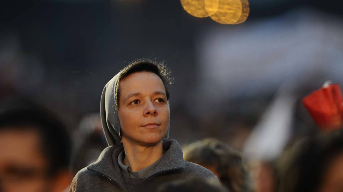 A nun waits in the crowd at the ancient Circus Maximus arena prior a prayer vigil on April 30, 2011 in Rome.