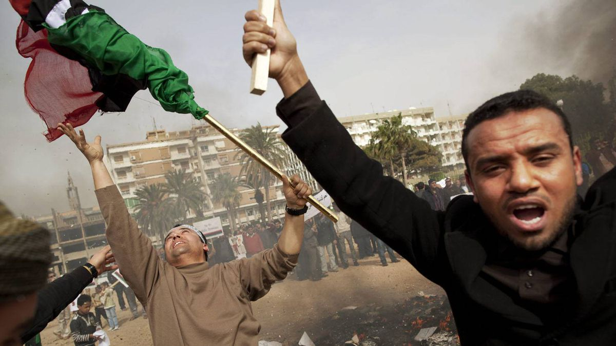 Libyan protesters shout as copies of Libyan leader Moammar Gadhafi's Green Book are burned during a demonstration in Benghazi, eastern Libya.