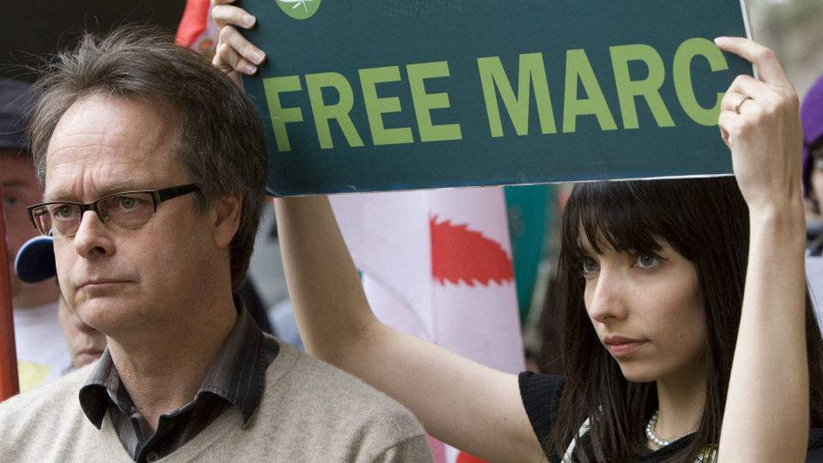 """Marc Emery, the self-described """"Prince of Pot"""" speaks to reporters outside the B.C. Supreme Court in Vancouver, Monday, May 10, 2010 prior to turning himself in to be extradited to the United States as his wife Jodie, right, looks on."""