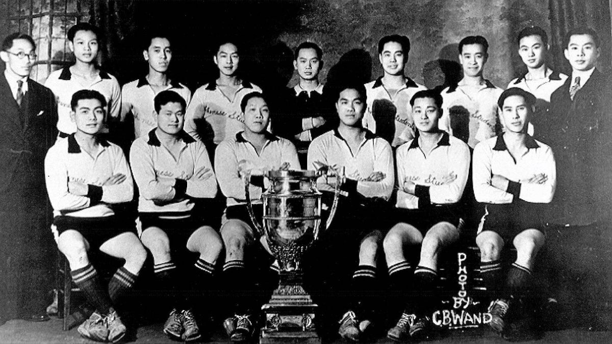 A photo of the 1933 soccer team. Standing (left to right) William Lore, Gibb Yip, Jackson Louie, Jack Soon, Shupon Wong, Horne Yip, Charlie Louie, Gam Jung, George Lam. Sitting: Lem On, Dock Yip, Art Yip, Quene Yip, Frank Wong, Buck S. Chung.