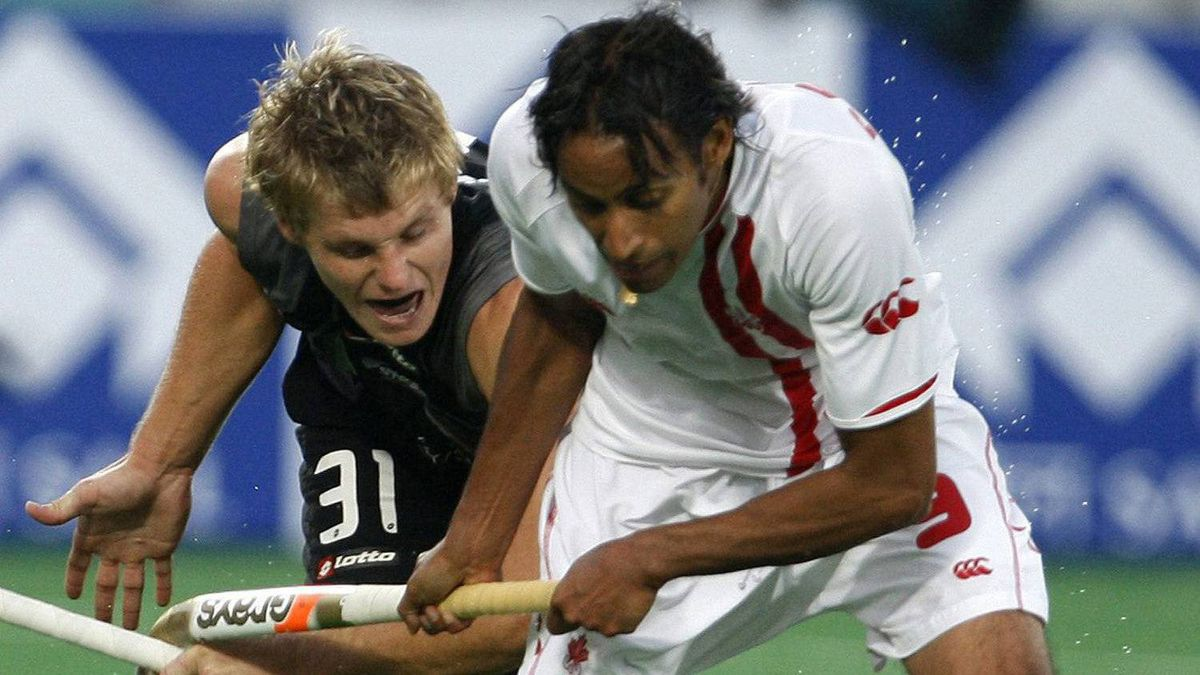 New Zealand's Steve Edwards, left, vies for the ball with Canada's Ken Pereira during the International Hockey Federation (FIH) World Cup 2010 field hockey match in New Delhi, India, Monday, March 1, 2010. After 17 years as friends and teammates, and close to 700 caps between them, Pereira and Rob Short hope to make at least one more international appearance together in London.