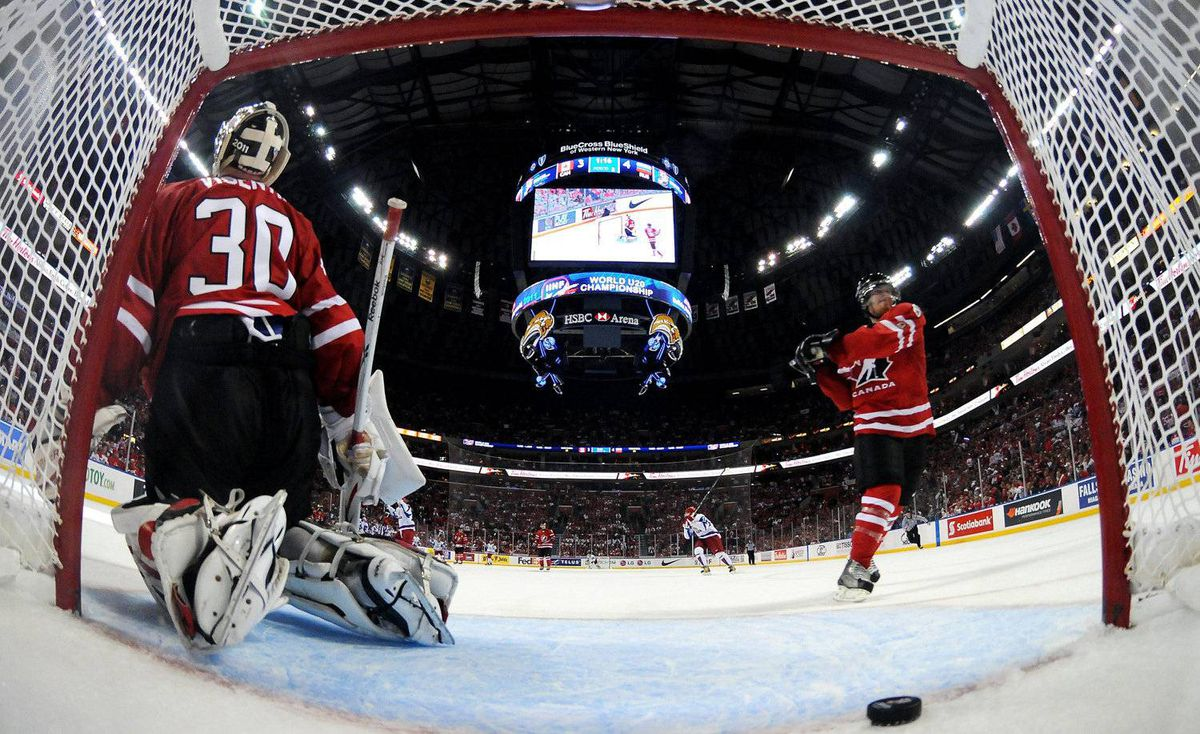 Team Canada goalie Mark Visentin, left, looks on with teammate and captain Ryan Ellis after Russia scored the game winning goal during third period IIHF World Junior Championship gold medal final hockey action in Buffalo, N.Y. on Wednesday, January 5, 2011.