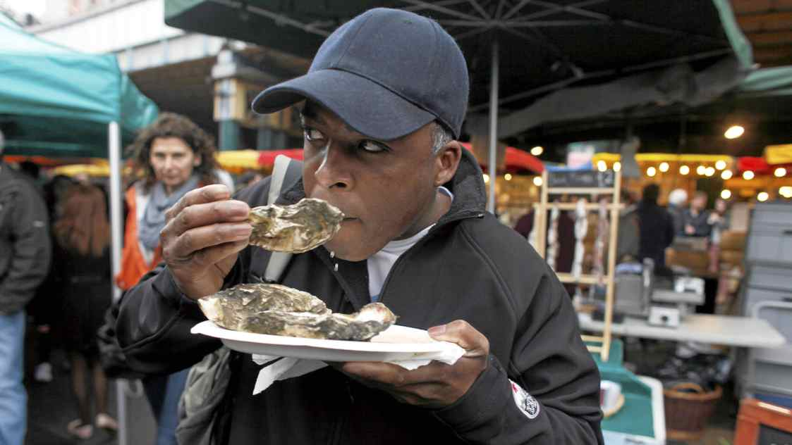 Dean Jacobs of Calgary tries the oysters at the famous Borough Market in London.