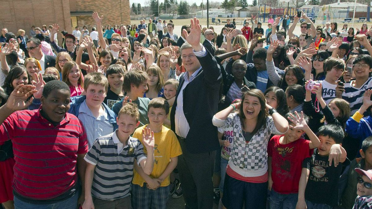 Prime Minister Stephen Harper greets school children after voting Monday, May 2, 2011 in Calgary as Canadians go to the polls in the federal election.