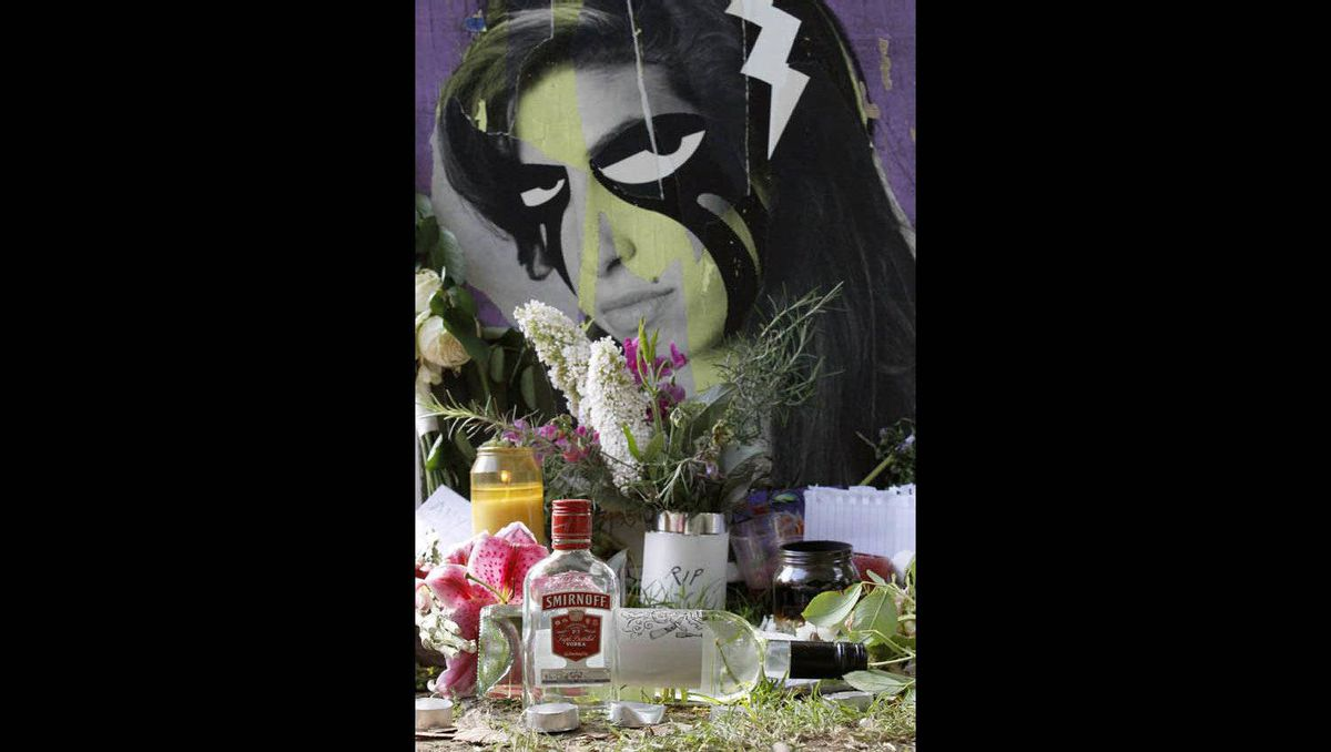 Flowers and tributes are seen outside the home of Amy Winehouse in London July 25, 2011.