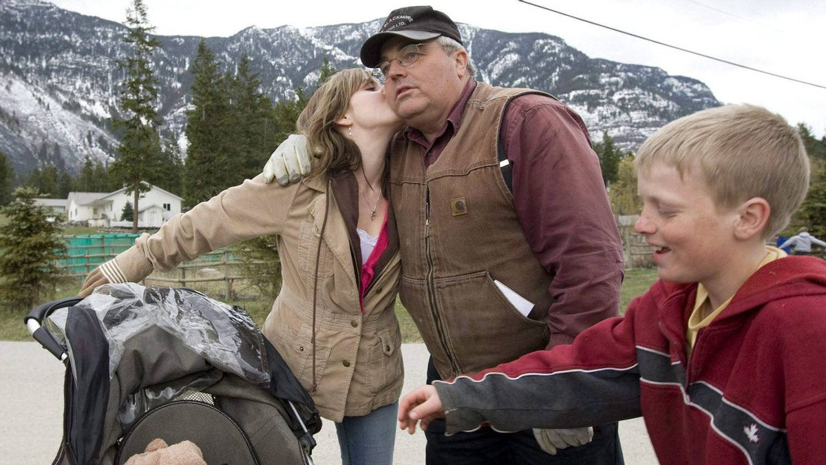 Winston Blackmore, the religious leader of the polygamous community of Bountiful, B.C., receives a kiss from one of his daughters as a son and a grandchild look on April 21, 2008 near Creston, B.C.