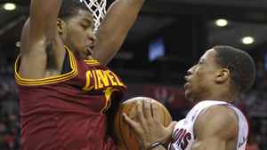 Toronto Raptors forward DeMar DeRozan and Cleveland Cavaliers defender Tristan Thompson (L) collide under the basket during the first half of their NBA basketball game in Toronto April 6, 2012. REUTERS/Mike Cassese