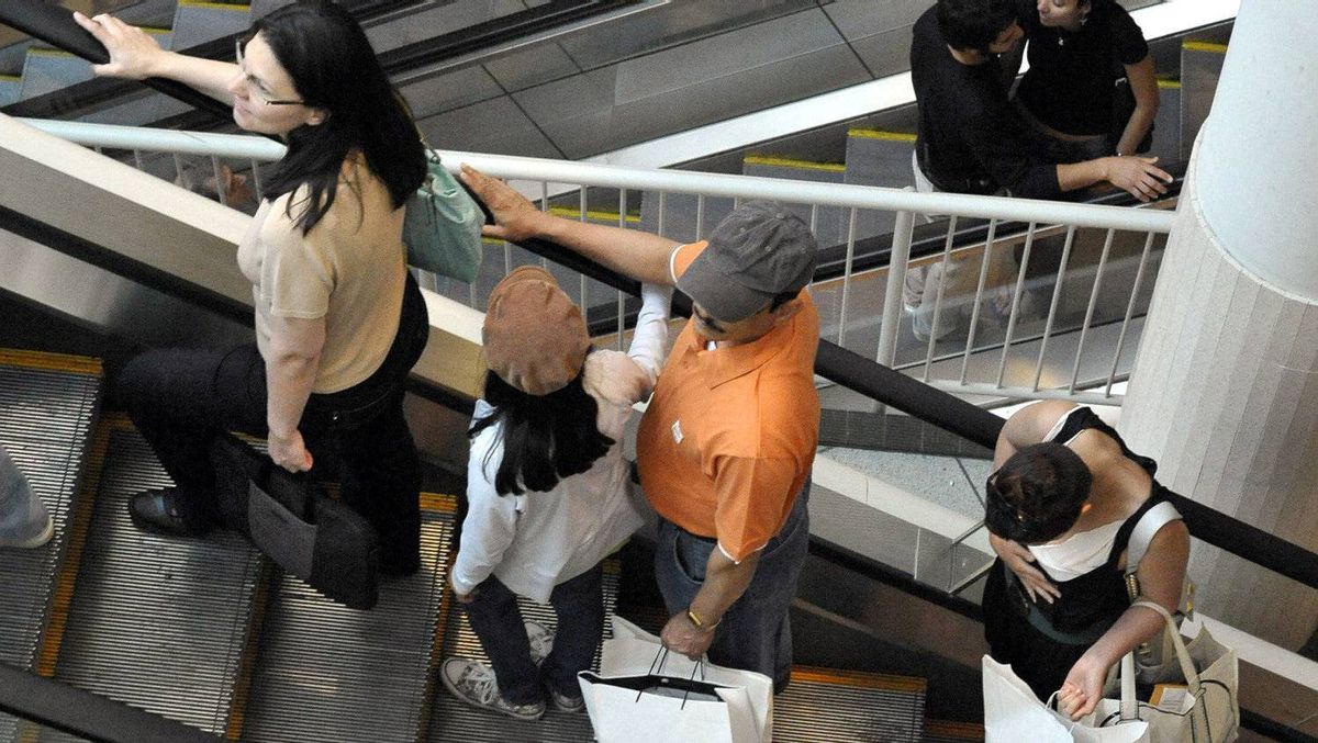 Shoppers carry their bags through the Eaton Centre in Toronto.