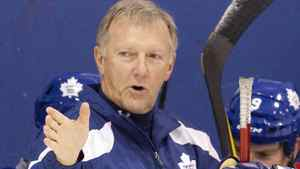 Toronto Maple Leafs Head Coach Ron Wilson (left) offers advice during practice on October 5, 2011. Photo by Chris Young for The Globe and Mail