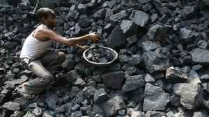 A labourer works at a wholesale coal shop, which is a part of state-owned coal India, in Noida, northern Indian state of Uttar Pradesh October 19, 2010.
