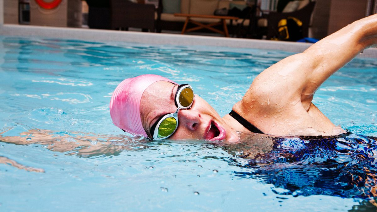 Nancy Black, a personal swim trainer, demonstrates how to freestyle swim using the correct breathing techniques on April 28, 2011.