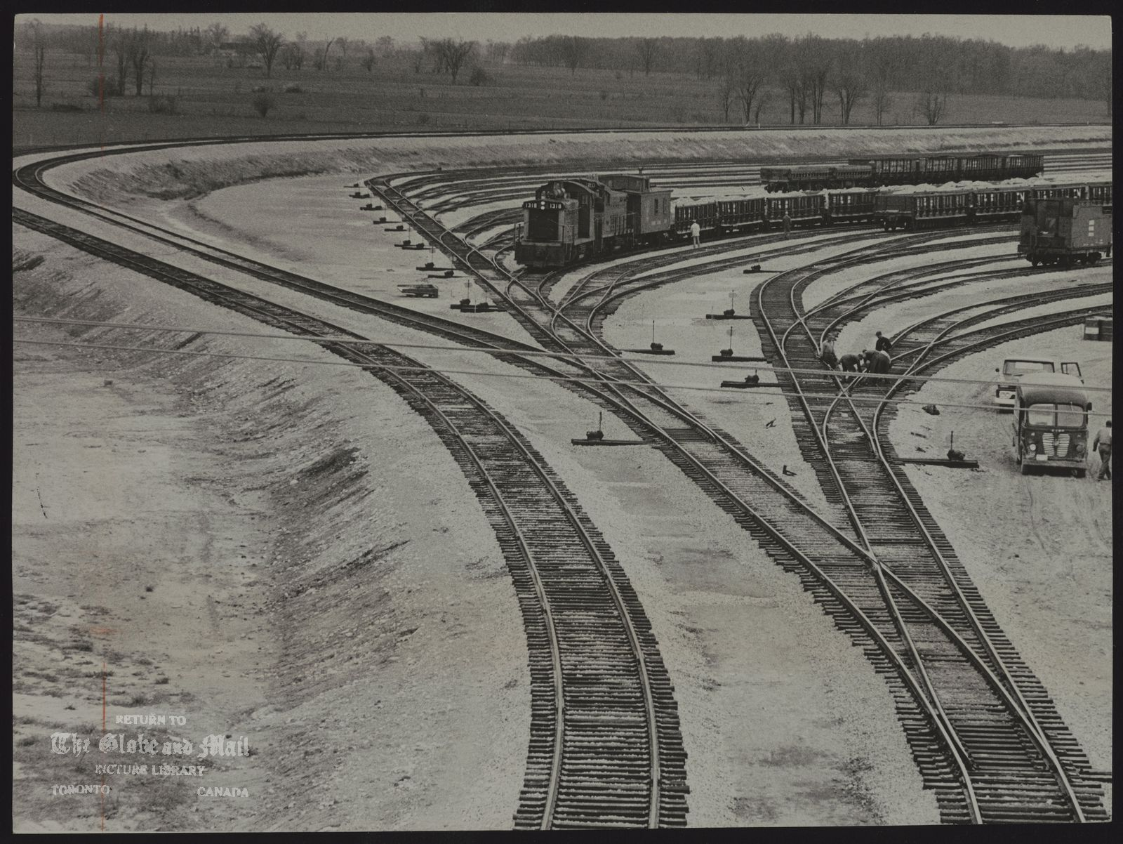 C.N.R. Miscellaneous AUTOMATED FREIGHT CLASSIFICATION YARD More than one-third of the 156 miles of track have been laid at the Canadian National Railways yard in northwestern Toronto, The yard forms part of the CNR Taronto bypass project which is scheduled to be in operation early in 1965.