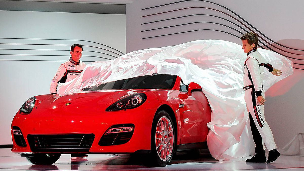 The new Porsche Panamera GTS is unveiled by race car drivers Romain Dumas (L) and Patrick Long at the LA Auto Show on November 16, 2011 in Los Angeles, California.