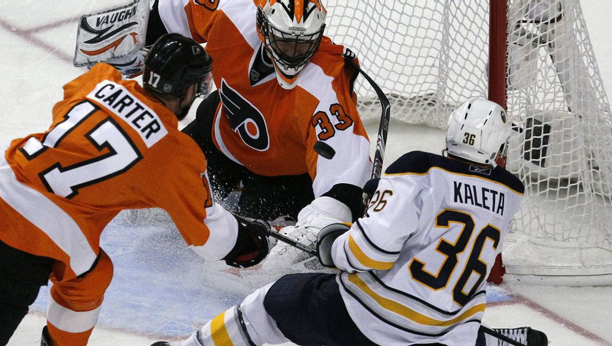 Philadelphia Flyers goalie Brian Boucher (C) handles the shot as the Flyers center Jeff Carter (17) hooks the Buffalo Sabres winger Patrick Kaleta (36) during the second period of Game 2 of their NHL Eastern Conference quarter-final hockey game in Philadelphia, Pennsylvania, April 16, 2011. The Flyers won 5-4. REUTERS/Tim Shaffer