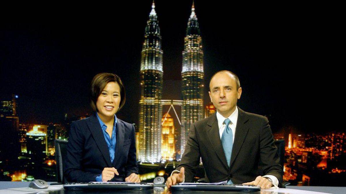News anchors Veronica Pedrosa and Teymoor Nabili at the Al Jazeera broadcast centre in Kuala Lumpur, Malaysia.