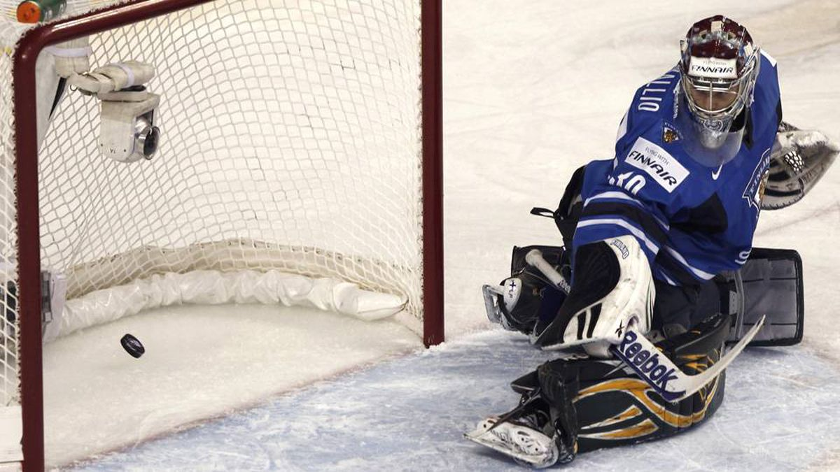 Finland's goalie Sami Aittokallio lets in a goal by Canada's Tanner Pearson in the first period of play.