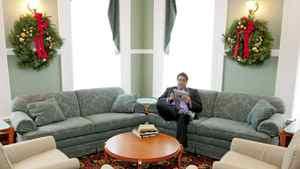 Calgary Mayor Naheed Nenshi reads on his iPad at the Grant McEwan Library at City Hall on Dec. 8, 2011.