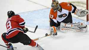 Philadelphia Flyers goaltender Brian Boucher, right, stops a shot by New Jersey Devils' Zach Parise during the first period of an NHL first-round playoff hockey game Thursday, April 22, 2010 in Newark, N.J. (AP Photo/Bill Kostroun)